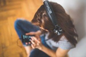 woman listening to music wearing black headphones
